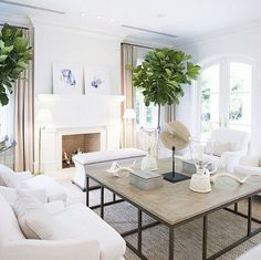 Living Room. Beach House living room with white walls, linen draperies, white furniture and neutral coastal decor.