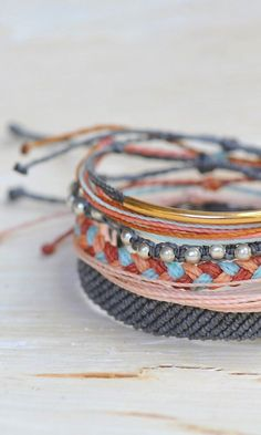 Grey, Coral, and Gold Style Bracelets