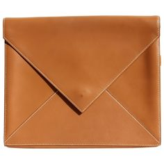 Natural barenia leather Hermes envelope clutch with white top stitching. Strap on the back to carry it by hand.