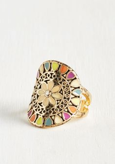 What's not to love about this golden statement ring? We guarantee that the rhinestone-centered bloom and the multicolored motif of this enamel-detailed accessory will jive with your far-out wardrobe. So, what are you waiting for? Grab this pretty piece and get the good times going!