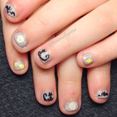 My Little Miss's Halloween nails.  She very specifically asked for gray background with black bats, black cats, white moons and yellow stars, all with glitter on them.  Inspired by Robin Moses. #nails #nailart #polish #nailpolish #mani #manicure #nailsofinstagram #halloween #halloweennails #halloweenailart
