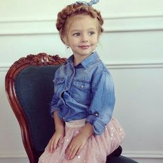 Cute little girl in jean jacket and pink sequence skirt