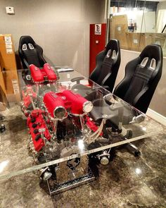 Our Office Racing Chairs look great when you tuck them in into our Twin Ferrari F430 Engine Conference Table! I'm sure this will make the board room a place for everyone to be!........... For more crazy and lavish automotive designs be sure to follow @tombatesdesign! For any inquiries please feel more than welcome to email nicolo@tombatesdesign.com.............................................................................................. #ferrari #lamborghini #watches #porsche #gtr #bmw…