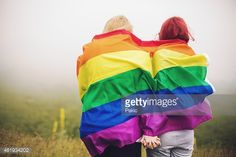 Stock Photo : Blonde and redhead woman wrapped in rainbow flag