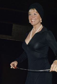 LOW NECKLINE - Doris Day in black dress & pearls