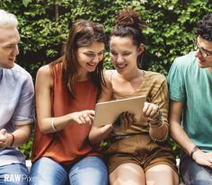 Free Premium Stock Photos - Friends using a tablet.