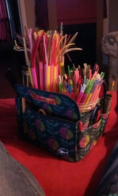 Quilling storage organization for strips and tools! Simple craft bag from store, i put tools in side pockets and used jumbo straws with one end melted together for the paper strips. Those are in two small plastic containers for easy removal.