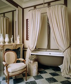 Old world style and sophisticated neutral color palette help to make this bathroom feel calm and regal. (homebunch.com)