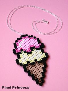 """A yummy two scoop ice cream cone made out of perler beads, attached to a 28 inch chain! PLEASE READ: if you are purchasing this necklace for a child, please choose the """"child size"""" option! Otherwise the necklace will be too long. ~ Custom Colors: This necklace can easily be made in other c..."""