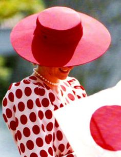 Diana in white dress with large red dots which Diana wore during her tour of Japan in 1986 to honor their flag.