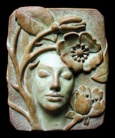 """""""Rose"""" by Jill Gibson. """"Inspired by the desire for healing the sacredness of nature, and the empowerment of the archetypal feminine energy and wisdom.  The image is my original design first sculpted with clay. I make a mold with Latex and from that comes a concrete plaque that is signed, and given a patina by hand, making it a one-of-a-kind sculpture of lasting value. Can be displayed outside.""""--Gibson"""