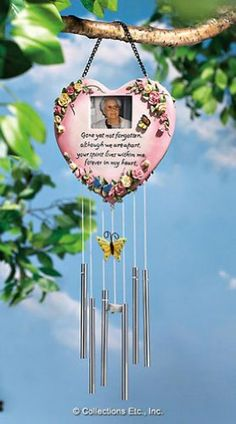 "Memorial Photo Dangler By Collections Etc by Natures Touch. $11.99. Fill the air with happy memories of a special someone. Embellished with sculpted flowers, butterflies and words of comfort. Features six harmonious chimes that ring out a celebration of a life. Hang it from a branch or a porch overhang. Measures 7 1/2""H x 8""W. Fill the air with happy memories of a special someone who has passed on. Memorial mobile features six harmonious chimes that ring out a celebrati..."