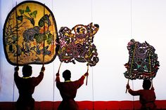 Performance of Nang Yai (large shadow puppets) at Wat Khanon temple.