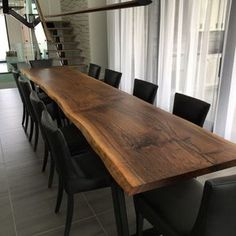 Live edge black walnut 12ft dining table from a single slab. www.boisdesign.co
