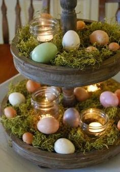 Easter Table Decoration With Eggs Candles And Moss