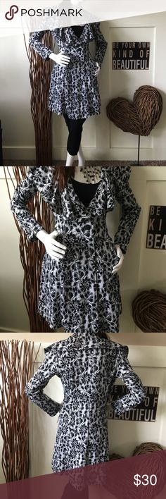 Fever floral knit jacket This pretty black and white floral jacket has two covered buttons at the waist ruffled collar and is kneelength looks pretty over capris or with your favorite skirt fever Jackets & Coats