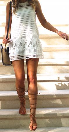 White lace mini dress, camel sandals and handbag. Summer trends 2015.