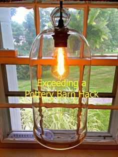 I exceeded a Pottery Barn hack with this glass cloche.  Check out how I did it!
