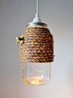 Bee aware.....our Mason jar lights are sweet as honey!  This half gallon sized Mason jar pendant lamp is ready to fit any space from country shabby