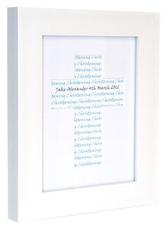 A personalised print set within a cross shaped mount. A fantastic, unique Christening gift!
