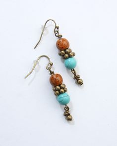 """Vi Bella Jewelry - Shelly Earrings - Crackled orange and turquoise beads and antique bronze look great together on the Shelly Earrings.  Wear with Shelly necklace and bracelet for a very unique, very """"Haiti"""" look!     Length - 2 Inches     Handcrafted by Vi Bella Artists in Haiti.  $14.95"""