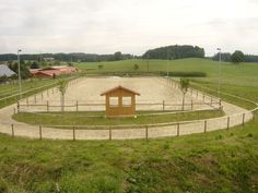 Outdoor horse riding arena with mini gallop track