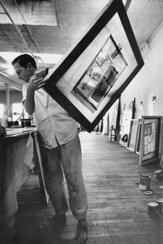 Rauschenberg at his studio at 809 Broadway, working with silkscreens, 1962.