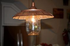Colander Light Fixture | Old made New.. this #upcycled colander light fixture combines an old ...