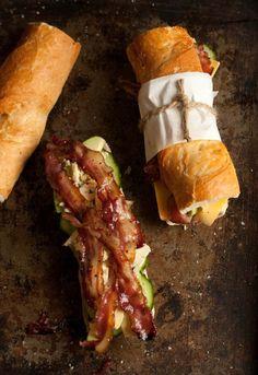 Bacon, avocado, brie cheese and garlic aioli sauce on crusty French bread rolls