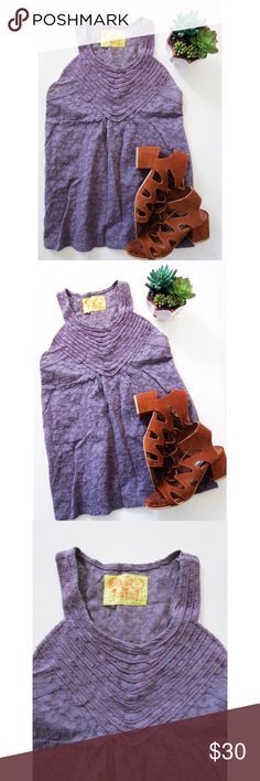Lavender lace Free People tank Beautiful lavender lace tank top from Free People. This tank top is super cute and can easily be dressed up or down! Beautiful lace detailing, making it great for all those lace lovers out there. Size medium, in excellent condition! Free People Tops Tank Tops