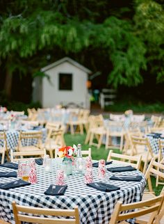 checkered table linens with wooden folding chairs for a laid-back reception or BBQ rehearsal dinner
