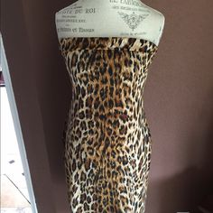 Convertible dress.Strapless or thin black straps Poly and spandex leopard spotted dress either strapless or with thin black straps. Very small fold over at the top with a slit in the back. Great fit. Never worn. Tags are off though. Moda International Dresses