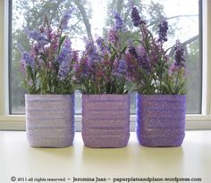 juice bottle glitter vases.Here's another beautiful way to recycle your plastic bottles