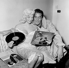 Diana Dors and Victor Mature share a vinyl moment