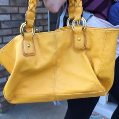 Yellow Aldo shoulder bag In used condition and priced accordingly. Gorgeous summer bright yellow color. Gold hardware. Some marks on the leather. The hardware is scuffed a lot. Outer is 100% pvc and inner is 70% polyester 30% cotton. Thanks for looking. ALDO Bags Shoulder Bags