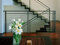 Wood and steel has been transformed to create a freestanding plane which has folded into a series of steps. This staircase becomes a sculptural element as a backdrop for the dining area. Design by Rouzita Vahhabaghai. Photo by Maxwell Mackenzie. Metal Stairs, Metal Railings, Staircase Railings, Stairways, Black Stairs, Cable Railing, Staircase Ideas, Banisters, Modern White Bathroom