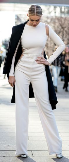 d4a51664f54 Gigi Hadid s feminine white jumpsuit at Lincoln Center. Models Off Duty