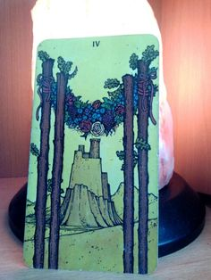 29/04/13 Four of wands from the Morgan Greer tarot. Enjoy your surroundings today & even if you don't get the chance to take a trip somewhere scenic then change something around at home, change the layout or look of a room, be creative - a change is as good as a rest.