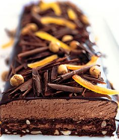 """All my favorite things are about chocolate,"" says Elizabeth Falkner. Thin layers of flourless chocolate cake and an intensely chocolaty… Flourless Chocolate Cakes, Chocolate Desserts, Köstliche Desserts, Delicious Desserts, Chocolates, Cake Recipes, Dessert Recipes, Chocolate Chip Ice Cream, Cacao"