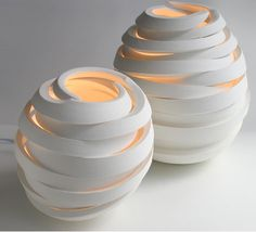 Cut Series Porcelain Lamps. These give off a feeling of warmth and the outer texture is so cool, especially since there are unsealed areas the show the glow from inside.