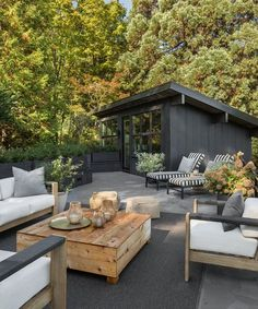 The roof terrace offers an outdoor lounge space, as well as views into the Seattle hills. Tagged: Outdoor, Raised Planters, Concrete Patio, Porch, Deck, Rooftop, Trees, Large Patio, Porch, Deck, and Planters Patio, Porch, Deck. Photo 13 of 17 in A 1957 Midcentury in Seattle Receives a Striking Makeover