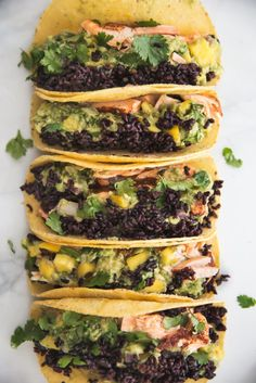 Heart-healthy food at its finest: Blackened Salmon Tacos with forbidden rice and an incredible mango guacamole. Options to bake or grill the salmon included!