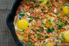 "Shakshuka - ""This North African egg dish is an integral part of the fabric that is Israeli cuisine, and it's commonly eaten for breakfast, lunch, or dinner, served in a sizzling cast iron pan, on a sandwich, or in a pita. Essentially eggs poached in tomato sauce"""