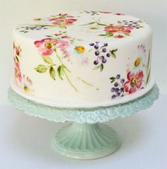 We love the painting style and flowers/colors on this cake. Would like to carry paper ware florals over to a painted cake.