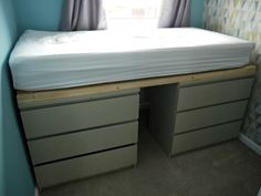 malm drawer hack to single bed Ikea Malm drawers hack, turning from drawers into a raised single bed. Spray painted with Valspar spray paint.Ikea Malm drawers hack, turning from drawers into a raised single bed. Spray painted with Valspar spray paint. Ikea Loft Bed Hack, Ikea Twin Bed, Ikea Hack Storage, Lp Storage, Record Storage, Ikea Malm Drawers, Bed With Drawers Underneath, Single Beds With Storage, Twin Storage Bed