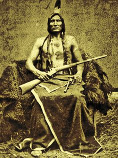 The youngest son of Lone Horn, Touch The Clouds assumed the leadership of the Minneconjou Teton Lakota after his father died in 1875. Two years later, this photo was taken of him at the Spotted Tail Agency in Nebraska, after he surrendered with his people. He holds a heavy-barreled Remington Rolling Block rifle and an 1873 Colt Cavalry revolver (also check out his military garrison belt).  – Courtesy Glen Swanson Collection –