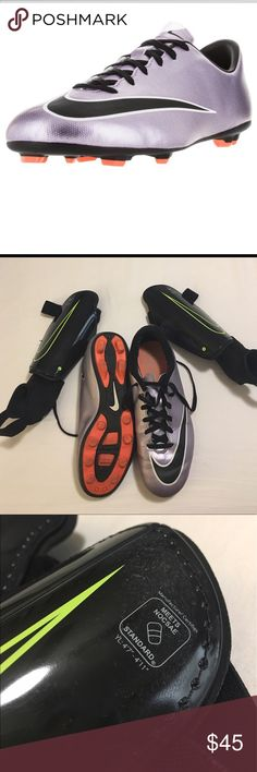 Y Nike soccer cleats size 5.5 bundle Nike Bundle of Youth soccer cleats size 5.5 including black and neon Nike youth size L shin guards. Soccer cleats were used for 1/2 season. They have some scuffs on the L shoe (in pic 4) but are still in great condition! Purple with black Nike check outlined in white with orange bottoms. Be sure to bundle and save! Nike Shoes Athletic Shoes