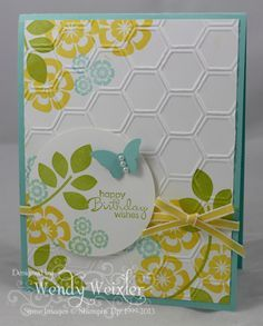 "Stamps: Betsy's Blossoms, Petite Pairs Paper:  Pool Party, Whisper White Ink:  Pool Party, Daffodil Delight, Lucky Limeade Accessories:  2 1/2"" Circle Punch, Elegant Butterfly Punch, Honeycomb Textured Impressions Embossing Folder, Daffodil Delight Taffeta Ribbon, Pearl Basics"