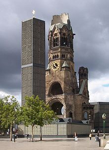 The Protestant Kaiser Wilhelm Memorial Church is located in Berlin on the Kurfürstendamm in the centre of the Breitscheidplatz. The original church on the site was built in the 1890s. It was badly damaged in a bombing raid in 1943. The present building, which consists of a church with an attached foyer and a separate belfry with an attached chapel, was built between 1959 and 1963.