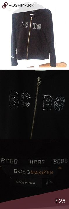 BCBG rhinestoned hoodie Worn once. Xl but definitely slimmer fitting. All rhinestones intact. Perfect like new condition. Zips up, silver zippers and rhinestones for a perfect bling. Very unique light weight hoodie. Best part is the actual hood; bedazzled and outlined in rhinestones, zippered in middle to wear as a hood or leave it open for long collared flaps. Pocketed in front. BCBGMaxAzria Tops Sweatshirts & Hoodies